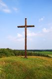 Cross. Wooden Cross on landscape with blue sky Stock Image