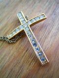 Cross. Christian religious jewellery, diamond & gold cross stock image