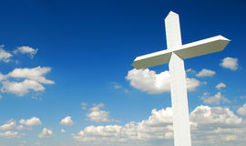 Cross. Giant white cross in a sunny day Royalty Free Stock Image