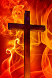 Cross. Over the fire background Stock Photography