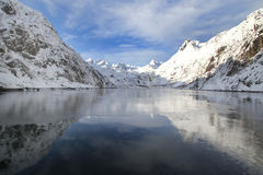 Cross. Mountains mirroring in the Trollfjord, arctic Norway Stock Image