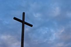 Cross. With blue sky background. This symbol is in Lobeira mountain, Spain Stock Photography