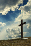 Cross. Silhouette on hilltop against dramatic sky stock photo