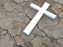Cross. Holy white Cross on dried ground Royalty Free Stock Image