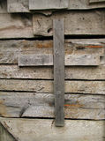 Cross. Wooden cross on wall stock image