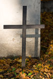 Cross. With its shadow against the gravestone Stock Images