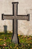 Cross. Metal cross against the gravestone Royalty Free Stock Images
