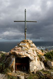 Cross. Catholic cross on a cliff with the sea to the bottom Stock Photos