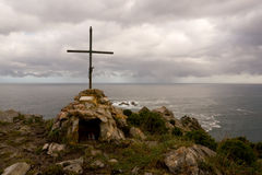 Cross. Catholic cross on a cliff with the sea to the bottom Royalty Free Stock Image