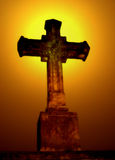Cross. A cross with a yellow sun in background royalty free stock images