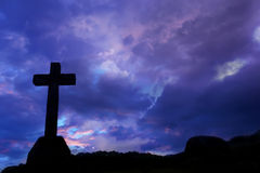 Cross. Silhouette and the clouds at sunset Royalty Free Stock Images