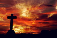 Cross. Silhouette and the clouds at sunset Stock Image