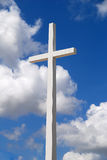 Cross. A huge religious cross on a beautiful partly cloudy blue sky royalty free stock image