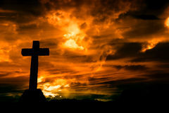 Cross. Silhouette and the clouds at sunset Royalty Free Stock Photo