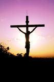 Cross. Beautiful cross with a sunset background stock photo