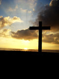 Cross. Christian cross silhouette at sunset Royalty Free Stock Photos