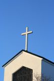 Cross. And church roof against a blue sky stock photography