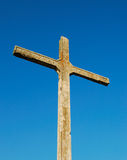 Cross. An old concrete cross over a clear blue sky Royalty Free Stock Photos