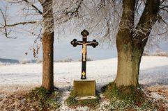 Cross. Wooden Cross in the winter nature Royalty Free Stock Images