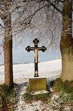 Cross. Wooden Cross in the winter nature Stock Image
