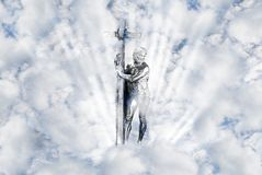 Cross. Silhouette of the cross with clouds of light royalty free stock image