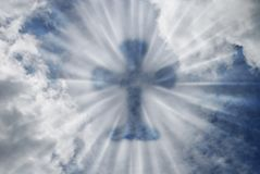 Cross. Silhouette of the cross with rays of light royalty free stock photography