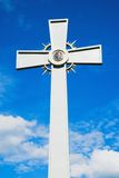 Cross. Metal cross with a face of Jesus Christ Royalty Free Stock Photo