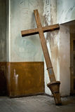 Cross in the abandoned church Stock Images