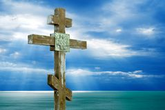 Cross above a sea. Christianity cross above a sea in the rays of light Stock Photos