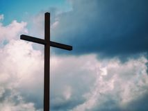 Cross against blue skies Royalty Free Stock Images