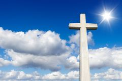 The Cross against the sky. The Cross against the blue sky and sunlight Royalty Free Stock Images