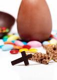Cross against easter chocolate eggs and sweets Stock Photo