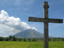 Cross against Mt. Mayon Royalty Free Stock Images