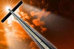 Cross Against the Orange Sky Stock Photos