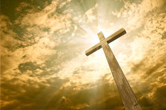 Cross against the sky. Wooden cross against the sky with shining rays Stock Photos
