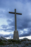 Cross against the sky. Christian cross silhouette on the top of the mountain. Bray, Ireland royalty free stock photos