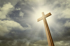 Cross against the sky. A cross against shining light on the sky royalty free stock image