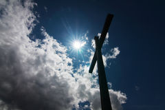 Cross against sun Stock Photos