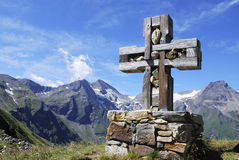 Cross in the alps Stock Image