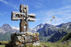 Cross in the alps Stock Photos
