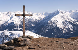 Cross in Alps. Wooden cross with the head of Jesus Christ on the top of the Ahorn mountain near Mayrhofen  in the Zillertal Alps in Austria Stock Photography