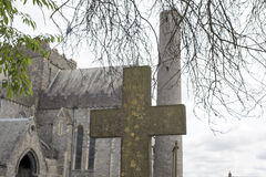 Cross at ancient graveyard in St Canice's Stock Images