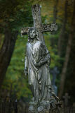 Cross and angel statue royalty free stock images