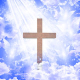 Cross and angelic forms. In blue sky Royalty Free Stock Images