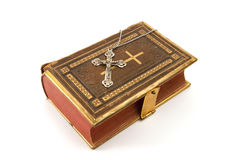 Cross on the Bible Stock Images