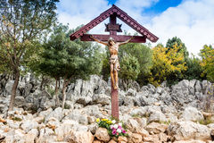 Cross on Apparition hill. Wooden Crucifixion Cross on Mount Podbrdo, the  Apparition hill overlooking the village of Medjugorje in Bosnia ed Erzegovina Stock Image