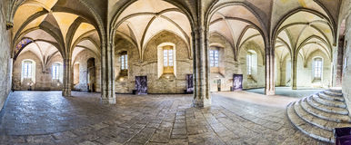 Cross arch room in the Papal Palace in Avignon. AVIGNON, FRANCE - DEC 9, 2015: Inside the popes palace in Avignon, France. The Papal palace is one of the largest stock image