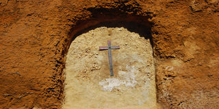 Cross in the arch. Wall of Castello di Lombardia. Cross in the arch. Aged photo. Wall of Castello di Lombardia. Outer wall of a castle. Religious symbol Royalty Free Stock Photo