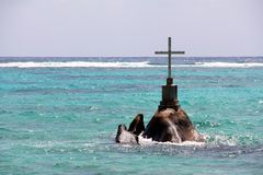 A cross as a Christian sanctuary at sea off the Seychelles Royalty Free Stock Image