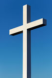 Cross as a symbol of Christianity with blue sky on background Stock Photos